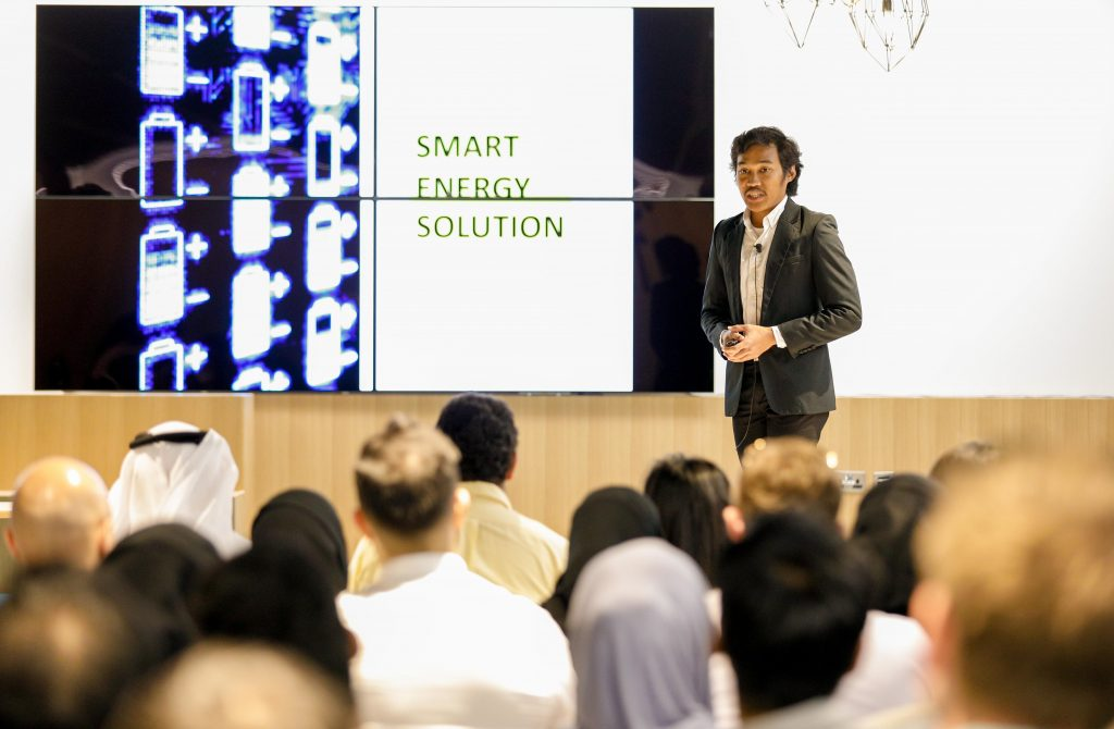 A guy is elaborating smart energy solutions